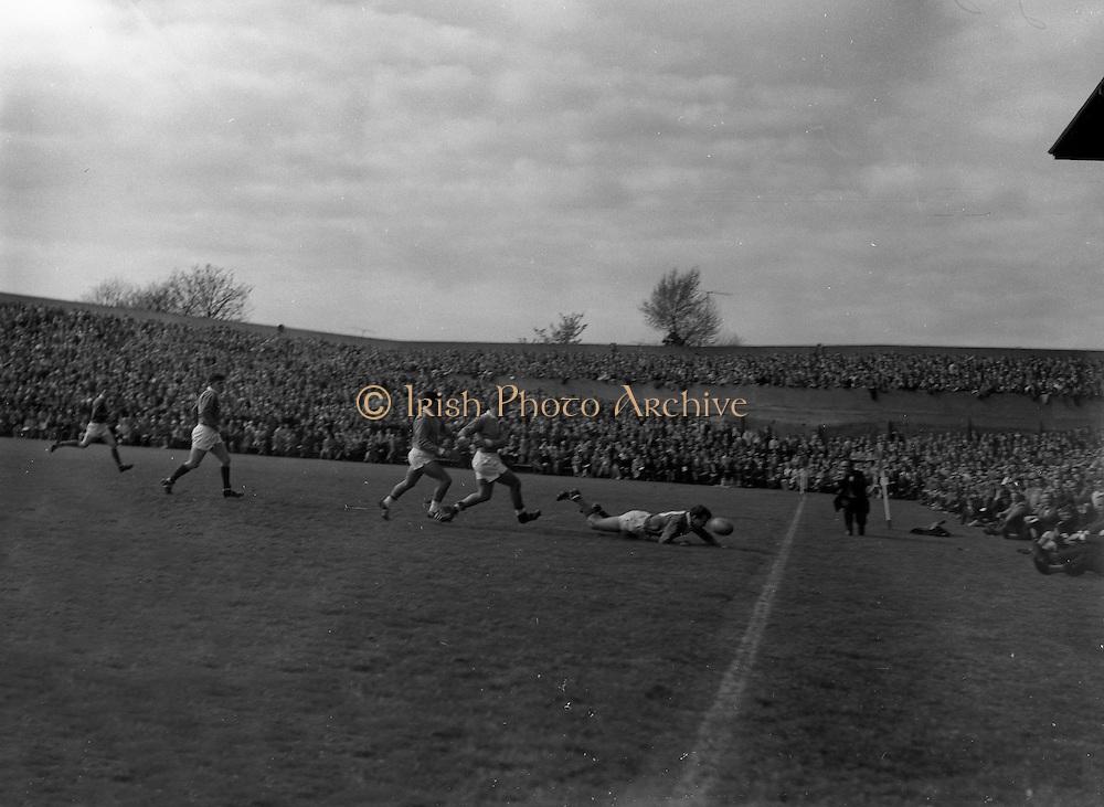 Irish Rugby Football Union, Ireland v France, Five Nations, Landsdowne Road, Dublin, Ireland, Saturday 15th April, 1961,.15.4.1961, 4.15.1961,..Referee- G J Treharne, ..Score- Ireland 3 - 15 France, ..Irish Team, ..T J Kiernan,  Wearing number 15 Irish jersey, Full Back, University college Cork Football Club, Cork, Ireland,  ..A J F O'Reilly, Wearing number 14 Irish jersey, Right Wing, Dolphin Rugby Football Club, Cork, Ireland, ..D Hewitt, Wearing number 13 Irish jersey, Right centre, Queens University Rugby Football Club, Belfast, Northern Ireland,..J C Walsh,  Wearing number 12 Irish jersey, Left Centre, University college Cork Football Club, Cork, Ireland,..N H Brophy, Wearing number 11 Irish jersey, Left wing, Blackrock Rugby Football Club, Dublin, Ireland, ..M A English, Wearing number 10 Irish jersey, Stand Off, Garryowen Rugby Football Club, Limerick, Ireland, ..A A Mulligan, Wearing number 9 Irish jersey, Scrum Half, London Irish Rugby Football Club, Surrey, England, ..B G Wood, Wearing number 1 Irish jersey, Forward, Landsdowne Rugby Football Club, Dublin, Ireland,..A R Dawson, Wearing number 2 Irish jersey, Captain of the Irish team, Forward, Wanderers Rugby Football Club, Dublin, Ireland, ..S Millar, Wearing number 3 Irish jersey, Forward, Ballymena Rugby Football Club, Antrim, Northern Ireland,..T J Nesdale, Wearing number 4 Irish jersey, Forward, Garryowen Rugby Football Club, Limerick, Ireland, ..C J Dick, Wearing number 5 Irish jersey, Forward, Ballymena Rugby Football Club, Antrim, Northern Ireland,..D Scott, Wearing number 6 Irish jersey, Forward, Malone Rugby Football Club, Belfast, Northern Ireland, ..J R Kavanagh, Wearing number 8 Irish jersey, Forward, Wanderers Rugby Football Club, Dublin, Ireland,..M G Culliton, Wearing number 7 Irish jersey, Forward, Wanderers Rugby Football Club, Dublin, Ireland, . .French Team, ..M Vannier, Wearing number 15 French jersey, Full Back, R C Chalon Rugby Football Club, France,..S Mericq, Wearing number 11 Fren