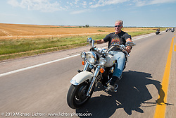 Gregory Mann riding back to Sturgis after the annual Michael Lichter - Sugar Bear Ride hosted by Jay Allen with the Easyriders Saloon during the Sturgis Black Hills Motorcycle Rally. SD, USA. Sunday, August 3, 2014. Photography ©2014 Michael Lichter.