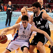 Anadolu Efes's Cedi Osman (L) and Besiktas's Engin Atsur (R) during their Turkish Basketball League match Anadolu Efes between Besiktas at Abdi Ipekci Arena in Istanbul Turkey on Sunday 03 May 2015. Photo by Aykut AKICI/TURKPIX