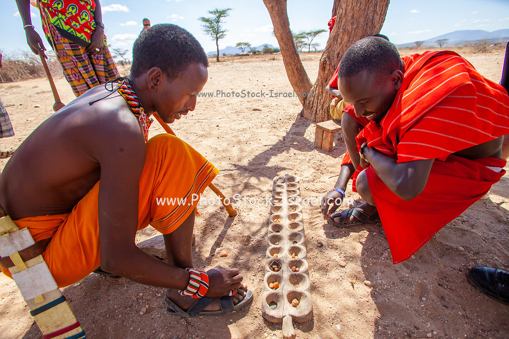 Young men of the Samburu tribe play Mancala. Mancala is one of the oldest known games to still be widely played today. Mancala is a generic name for a family of two-player turn-based strategy board games. The Samburu are a Nilotic people of north-central Kenya. Samburu are semi-nomadic pastoralists who herd mainly cattle but also keep sheep, goats and camels.