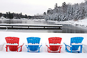 Muskoka chairs covered in snow in winter<br />Port Carling<br />Ontario<br />Canada