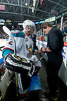 KELOWNA, CANADA - JANUARY 16: Athletic Therapist Scott Hoyer examines the hand of Chance Braid #22 of Kelowna Rockets on the bench against the Seattle Thunderbirds on January 16, 2015 at Prospera Place in Kelowna, British Columbia, Canada.  (Photo by Marissa Baecker/Shoot the Breeze)  *** Local Caption *** Chance Braid; Scott Hoyer;