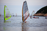 Windsurfing in the calm waters off Songlanshan beach in zhejiang province, china.