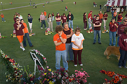 Blacksburg, Va. UNITED STATES: Mourners grieve at a memorial for the victims of the shooting massacre at Virginia Tech University in Blacksburg, Virginia April 20, 2007. A 23-year-old student from South Korea was identified as the gunman who carried out the deadliest school shooting in US history.  33 people died on Monday, police named the gunman as Cho Seung-Hui, a student at the school and resident alien in the United States. (AMi Vitale)