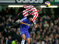 Photo: Tom Dulat/Sportsbeat Images.<br /> <br /> Chelsea v Sunderland. The FA Barclays Premiership. 08/12/2007.<br /> <br /> Danny Higginbotham of Sunderland jumps over Chelsea's Claudio Pizarro to get the ball.