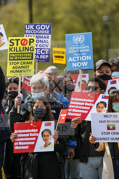 Demonstrators chant and hold placards and banners against Myanmar's ruling junta are gathered outside the Houses of Parliament, Westminster Palace in central London on Sunday, May 2, 2021. This is a series of protests following the locked out of the Myanmar envoy to the UK from the embassy three weeks ago on April 7. Myanmar's ambassador to the UK, Kyaw Zwar Minn, said the embassy has been seized by the military attache. (Photo/ Vudi Xhymshiti)