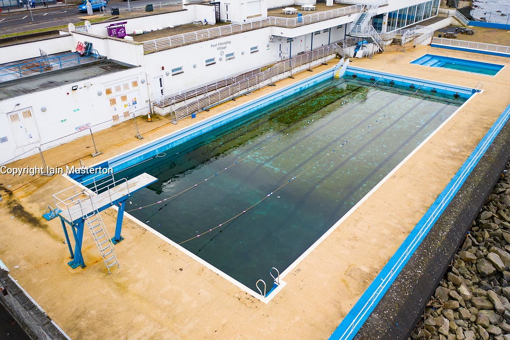 Gourock, Scotland, UK. 9 Mar 2021. Coronavirus lockdown has meant Gourock outdoor swimming pool has been closed to the public for months and the water in the pool has become stagnant and dirty. Much maintenance and cleaning will be required to bring the pool to readiness when lockdown is relaxed. Iain Masterton/Alamy Live News