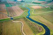 Nederland, Noord-Brabant, Werkendam, 28-10-2014; Ruimte voor de Rivier project Ontpoldering Noordwaard. Grondwerk t.b.v. de aanleg van meanderende kreken.<br /> De Noordwaard wordt ontpolderd door de dijken aan de rivierzijde gedeeltelijk af te graven, hierdoor kan de Nieuwe Merwede bij hoogwater via de Noordwaard sneller naar zee stromen. Gevolg van de ingrepen is ook dat de waterstand verder stroomopwaarts zal dalen.<br /> National Project Ruimte voor de Rivier (Room for the River) By lowering and / or moving the dike of the Noordwaard polder the area will become subject to controlled inundation and function as a dedicated water detention district. Houses and farmhouses will be constructed on new dwelling mounds. <br /> luchtfoto (toeslag op standard tarieven);<br /> aerial photo (additional fee required);<br /> copyright foto/photo Siebe Swart