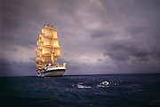 A clipper ship sails through the water of the Mediterranean Sea, off the coast of Italy