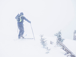 Man Skiing on a snowy day in the black forest