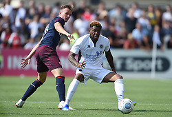 Arsenal's Rob Holding (left) and Boredom Wood's Morgan Ferrier during the pre-season match at Meadow Park, Boreham Wood.