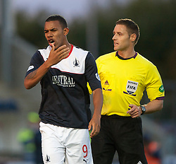 Falkirk's Phil Roberts with ref Steven McLean.<br /> Falkirk 2 v 1 Dunfermline, Scottish League Cup, 27/8/2013, at The Falkirk Stadium.<br /> ©Michael Schofield.