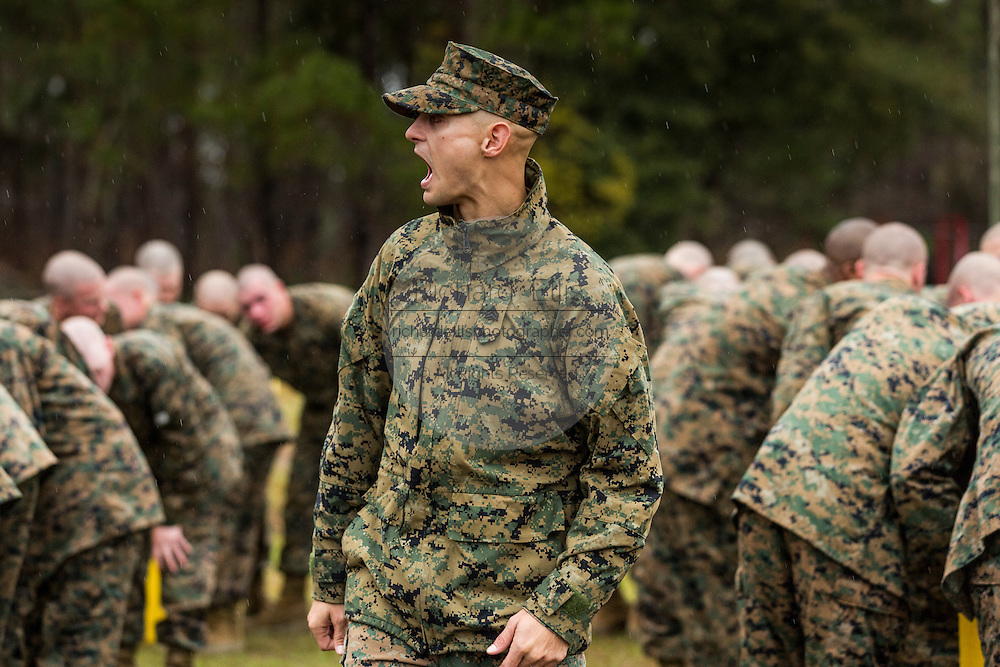 US Marine Corps drill instructor shouts instructions to recruits after exiting the gas chamber during bootcamp January 13, 2014 in Parris Island, SC.