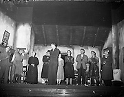 """25/05/1959<br /> 05/25/1959<br /> 25 May 1959<br /> Listowel Drama Group performs """"Sive"""" at the Abbey Theatre (Queens Theatre), Dublin. After the first night the audience calls for author brought Mr. John B. Keane, author of """"Sive"""", on stage, who paid a tribute to the players.  Picture shows Mr. Keane (centre) applauding the players."""