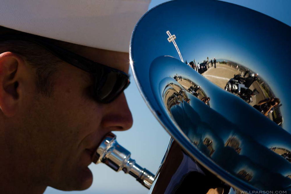 The Mt. Soledad Veterans Memorial cross is reflected in the bell of MU1 (Musician First Class) Evan Vis' euphonium while he warms up with the rest of Navy Band Southwest in La Jolla, California on November 08, 2008.  The group later performed during a special ceremony for the late actor Jimmy Stewart.