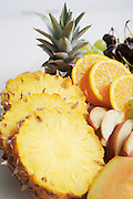 Freshly cut fruit platter with banana, pineapple, watermelon, grapes, apple and orange