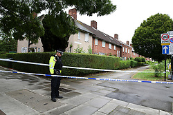 © Licensed to London News Pictures. 05/08/2019. London, UK. A police officer guards the crime scene on Waltheof Gardens in Tottenham, north London. Police launch a murder investigation following a death of a woman at an address in Waltheof Gardens. Police were called around 10:45 am on 4 August 2019 where the body of an 89-year-old woman was found. According to the police one or more suspects gained entry to the woman's house between Saturday (3 August) evening and Sunday (4 August) morning. Photo credit: Dinendra Haria/LNP
