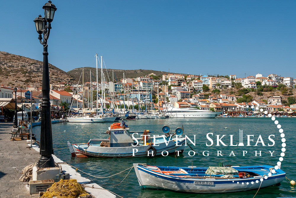 Samos. Greece. Colourful fishing boats docked in the pretty harbour of Pythagoreio. The town is the most popular and fashionable on the island and was named after the great philosopher Pythaogaras who was born here in 580 BC.