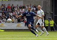 Photo: Adam Davies.<br />Swansea City v Southend United. Coca Cola League 1. <br />Sounthend's lewis hunt and swansea's andy robinson.<br />29/04/2006.<br />Sounthend's Lewis Hunt and Swansea's Andy Robinson.