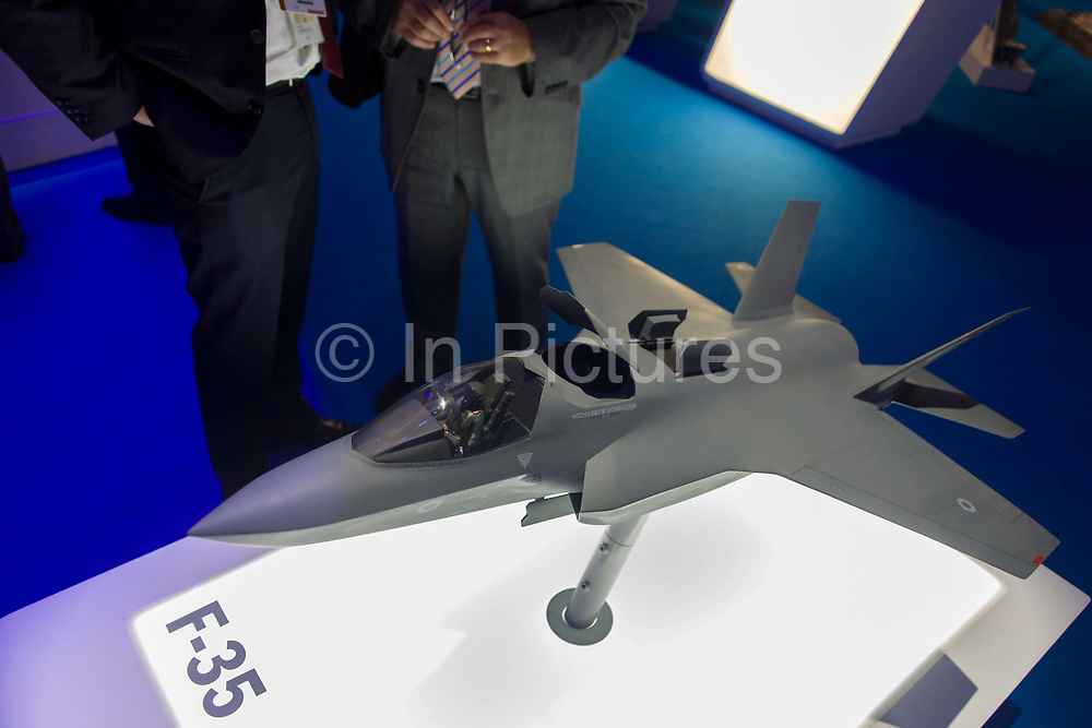 F-35 stealth Joint Strike Fighter presentation model, exhibited at the Farnborough Air Show, England. The Lockheed Martin F-35 Lightning II is a family of single-seat, single-engine, fifth-generation multirole fighters under development to perform ground attack, reconnaissance, and air defense missions with stealth capability. The F-35 is the fighter due to fly from Britain's sole aircraft carrier, the BAE Systems-built Queen ELizabeth. BAE Systems plc is a British multinational defence, security and aerospace company headquartered in London in the United Kingdom and with operations worldwide.