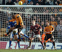 Photo: Ed Godden.<br />Wolverhampton Wanderers v Ipswich Town. Coca Cola Championship. 18/02/2006. <br />Joleon Lescott, heads the ball over for Wolves.