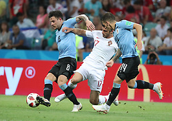 SOCHI, June 30, 2018  Goncalo Guedes (C) of Portugal vies with Nahitan Nandez of Uruguay during the 2018 FIFA World Cup round of 16 match between Uruguay and Portugal in Sochi, Russia, June 30, 2018. (Credit Image: © Ye Pingfan/Xinhua via ZUMA Wire)
