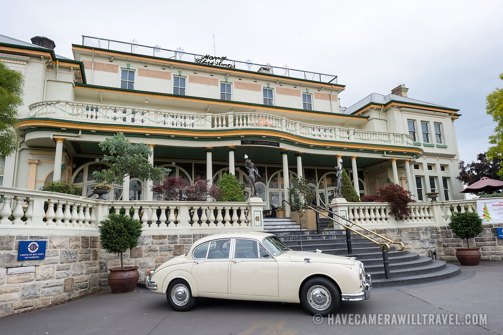 A vintage Jaguar parked outside the Carrington Hotel in Katoomba in the Blue Mountains of New South Wales, Australia. The Carrington is a grand old hotel established in 1880.