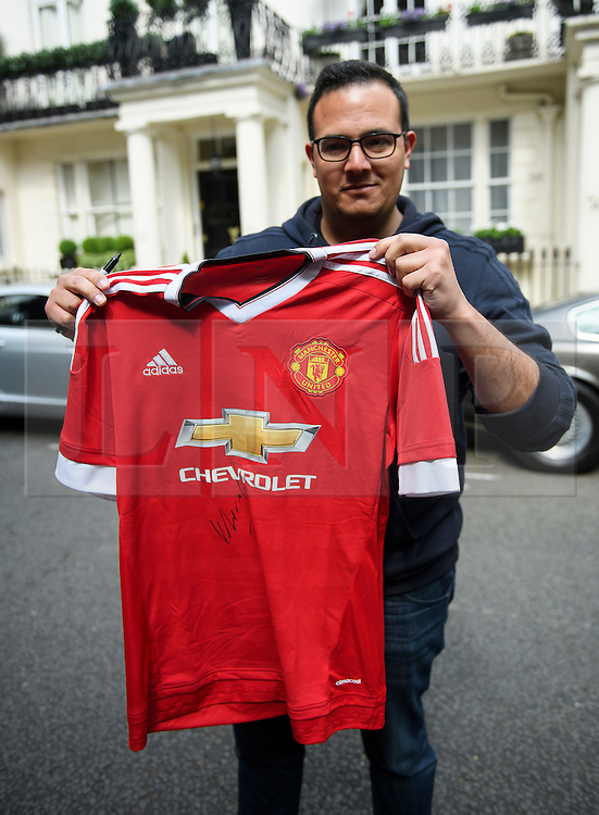 © Licensed to London News Pictures. 27/05/2016. London, UK.  STEVEN RIBEIRO holds up his Manchester United FC shirt which was signed by Jose Mourinho as he  left his home in west London on the day he was officially announced as the new manager of Manchester United Football Club. Photo credit: Ben Cawthra/LNP