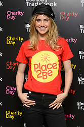 © Licensed to London News Pictures. 27/10/2016. SUKI WATERHOUSE takes part in trading at Bloomberg, encouraging stockbrokers and companies to make donations to their chosen charities. London, UK. Photo credit: Ray Tang/LNP