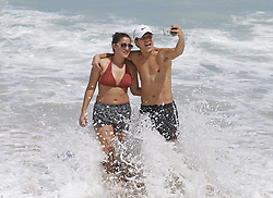 Beck Jumaev and Selina Garcia of Miami take selfies at Haulover Beach in the Hurricane Irma aftermath on Tuesday, September 12, 2017, in Miami Beach. Photo by David Santiago/El Nuevo Herald/TNS/ABACAPRESS.COM