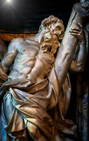 """""""Saint Andrew - San Giovanni in Laterano Rome""""...<br /> <br /> Andrew was Saint Peter's brother, and was called with him. """"As [Jesus] was walking by the Sea of Galilee, he saw two brothers, Simon who is now called Peter, and his brother Andrew, casting a net into the sea; they were fishermen. He said to them, 'Come after me, and I will make you fishers of men.' At once they left their nets and followed him"""" (Matthew 4:18-20). Legend has it that Andrew preached the Good News in what is now modern Greece and Turkey and was crucified at Patras on an X-shaped cross. Dedicated to St. John the Baptist and St. John the Evangelist, the Basilica of St. John Lateran is the first among the four major basilicas of Rome. It is also the Cathedral of the Bishop of Rome, the Pope, and is thus known as the """"Cathedral of Rome and of the World."""" Built by Constantine the Great in the 4th century, San Giovanni in Laterano was the first Christian/Catholic church erected in Rome. The present structure of the Basilica resembles Saint Peter's Basilica, and the ancient church was residence of the Papacy until the (1377) return from exile in Avignon and permanent relocation to the Vatican. Many Popes were responsible for repair and additions to the Basilica's overall splendor and importance throughout the last 1700 years. In 1702, Pope Clement XI announced a grand scheme for twelve sculptures of the Apostles to fill the niches left in the nave of the Basilica. One cannot help being impressed by the larger than life statues of these great men blessing the nave with their imposing presence. Camillo Rusconi was an Italian sculptor of the late Baroque in Rome. Camillo's masterpieces are the four larger-than-life apostles (Matthew, James the Great, Andrew, and John) completed during 1708-1718 for the niches of the Archbasilica of St. John Lateran."""