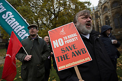 © licensed to London News Pictures. London, UK 12/11/2012. Farm workers protesting against plans to abolish the Agricultural Wages Board by the Government, outside the Houses of the Parliament on 12/11/12. Photo credit: Tolga Akmen/LNP