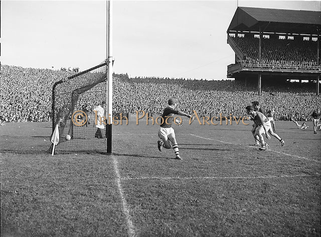 Galway goalie J. Parnell, puzzled as Kerrys 3rd goal shoots into the net during the All Ireland Senior Gaelic Football Championship Final, Kerry vs Galway in Croke Park on the 27th September 1959. Kerry 3-7 Galway 1-4.