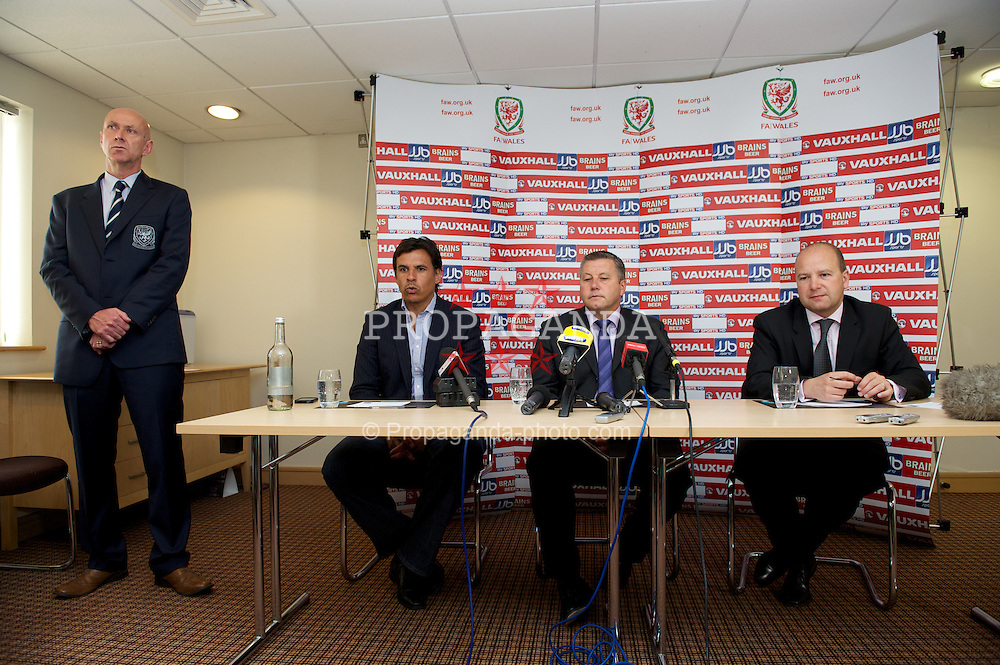 CARDIFF, WALES -.Tuesday, July 10, 2012: Wales' manager Chris Coleman with the new Indermediate Team Manager Geraint Williams and Chief-Executive Jonathan Ford during a press conference at the Village Hotel. (Pic by David Rawcliffe/Propaganda)