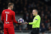 Goalkeeper Peter Gulacsi Of Leipzig and \Referee Cuneyt Cakir during the UEFA Champions League match between Tottenham Hotspur and RB Leipzig, at The Tottenham Hotspur Stadium, Thursday, Feb. 20 2020,  in  London, United Kingdom. (Mitchell Gunn/Image of Sport)