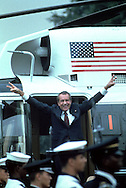 Former President Richard Nixon waves as he boards the Marine helicopter on the South Lawn of the White House on August 9, 1974..Photograph by Dennis Brack bb24