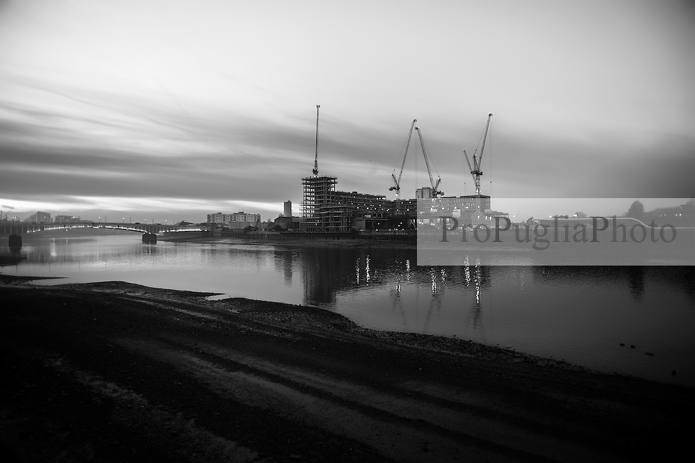 Thames view towards Fulham Wharf. Cranes have become a symbol of London skyline, a costant presence that is evolving London cityscape.