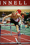 Austin Curbow strides over the final hurdle of the 60m hurdle competition on Friday at the NCAA Division III Indoor Track and Field National Championships at Grinnell College. Curbow is ranked 1st going into the finals on Saturday..