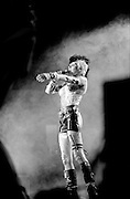 Wendy O Williams and the Plasmatics<br /> WOW arms out in cloud of smoke