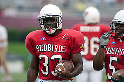 24 SEP 2005<br /> <br /> Running backs Ansu Kpaandeyenge (33) and Brian Thompson of the Illinois State Redbirds walk the sidelines prior to the start of the game.<br /> <br /> The Illinois State University Redbirds are victorious with a shut out score of 42 - 0 over Murray State Racers during the Hall of Fame Game held at Hancock Stadium on Illinois State University campus in Normal IL