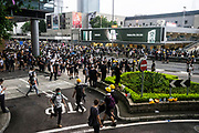 Protesters occupy roads near the Central Government Offices, during a protest against a proposed extradition law in Hong Kong, SAR China, on Wednesday, June 12, 2019. Hong Kong's legislative chief postponed the debate on legislation that would allow extraditions to China after thousands of protesters converged outside the chamber demanding the government to withdraw the bill. Photo by Suzanne Lee/PANOS