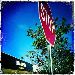 Stop sign at Wal-Mart. Orlando holiday 2012. Photo taken with the Hipstamatic photo application on Apple iPhone 4.