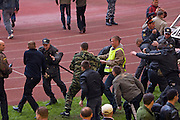 Moscow, Russia, 16/05/2008..Russian OMON special forces riot police practice preventing a pitch invasion inside Luzhniki stadium, location for the forthcoming European Champion's Cup final between Manchester United and Chelsea. The role of rioting fans was played by fellow police as Moscow authorities prepare to deal with some 50,000 visiting English football fans.