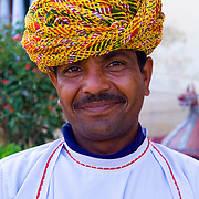 A Rajasthani musician outside the old palace of Bhadrawati in Bhandarej, Rajasthan, India.