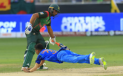 September 21, 2018 - Dubai, United Arab Emirates - Indian cricketer Yuzvendra Chahal drops a catch as Bangladesh's Mahmudullah Riyaz looks on during the 1st cricket match of the Super four group  of Asia Cup 2018 between India and Bangaldesh at Dubai International cricket stadium,Dubai, United Arab Emirates on 21 September 2018. (Credit Image: © Tharaka Basnayaka/NurPhoto/ZUMA Press)