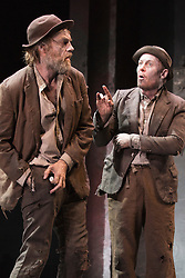 "© Licensed to London News Pictures. 05/06/2015. London, UK. L-R: Hugo Weaving as Vladimir and Richard Roxburgh as Estragon. Actors Richard Roxburgh and Hugo Weaving star in Samuel Beckett's ""Waiting for Godot"" at the Barbican Theatre. Part of the International Beckett Season, this Sydney Theatre Company play is directed by Andrew Upton. With Luke Mullins as Luke, Philip Quast as Pozzo, Richard Roxburgh as Estragon and Hugo Weaving as Vladimir. Performances from 4 to 13 June 2015 at the Barbican Theatre. Photo credit : Bettina Strenske/LNP"