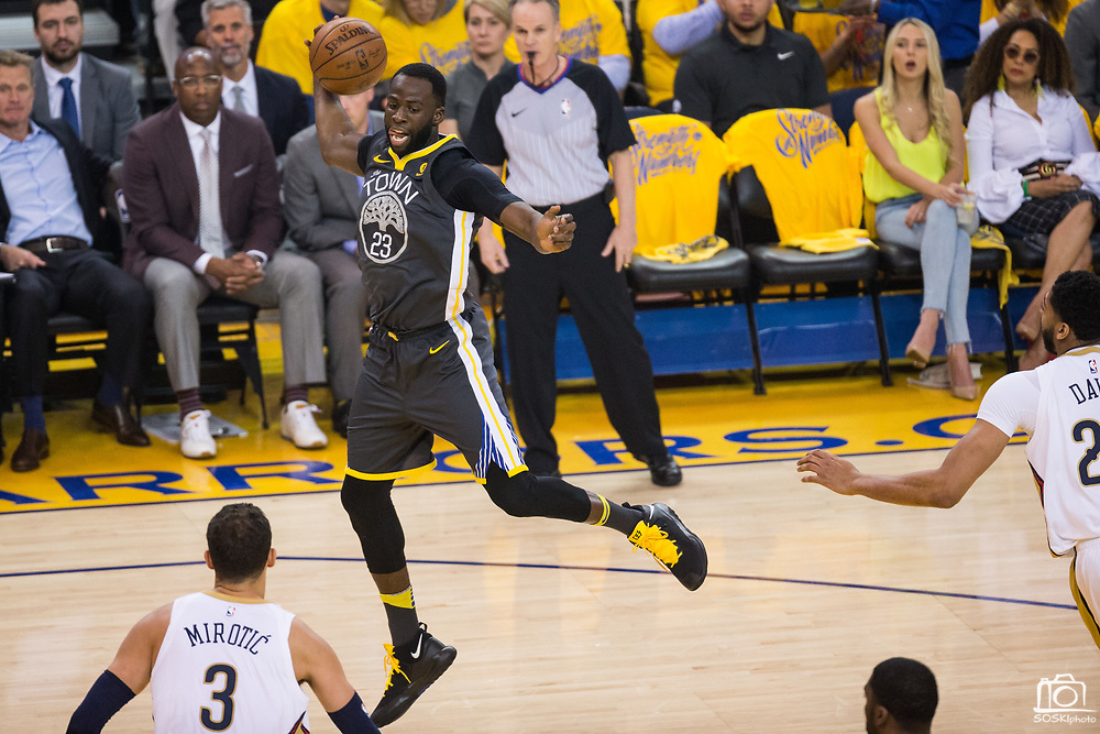 Golden State Warriors forward Draymond Green (23) catches a wild pass against the New Orleans Pelicans at Oracle Arena during Game 2 of the Western Semifinals in Oakland, California, on May 1, 2018. (Stan Olszewski/Special to S.F. Examiner)