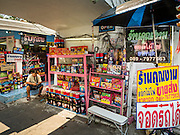 07 APRIL 2016 - BANGKOK, THAILAND: A fireworks vendor in the entrance to Mahakan Fort. The community is known for fireworks, fighting cocks and bird cages. Mahakan Fort was built in 1783 during the reign of Siamese King Rama I. It was one of 14 fortresses designed to protect Bangkok from foreign invaders, and only of two remaining, the others have been torn down. A community developed in the fort when people started building houses and moving into it during the reign of King Rama V (1868-1910). The land was expropriated by Bangkok city government in 1992, but the people living in the fort refused to move. In 2004 courts ruled against the residents and said the city could take the land. The final eviction notices were posted last week and the residents given until April 30 to move out. After that their homes, some of which are nearly 200 years old, will be destroyed.       PHOTO BY JACK KURTZ