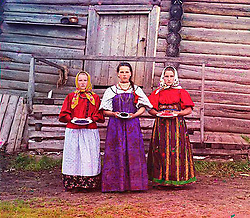 What Russian Empire Looked Like Before 1917… In Color..The Sergei Mikhailovich Prokudin-Gorskii Collection features colour photographic surveys of the vast Russian Empire made between ca. 1905 and 1915. Frequent subjects among the 2,607 distinct images include people, religious architecture, historic sites, industry and agriculture, public works construction, scenes along water and railway transportation routes, and views of villages and cities. An active photographer and scientist, Prokudin-Gorskii (1863-1944) undertook most of his ambitious colour documentary project from 1909 to 1915. ..Photo Shows; Sergei Three young women offer berries to visitors to their izba, a traditional wooden house, in a rural area along the Sheksna River, near the town of Kirillov..©Library of Congress/Prokudin-Gorskii/Exclusivepix Media (Credit Image: © Exclusivepix media via ZUMA Press)