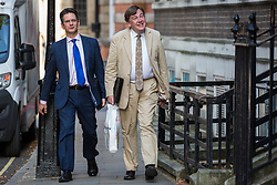 London, UK. 23 July, 2019. Steve Baker MP (l), Deputy Chair of the pro-Brexit European Research Group (ERG), and John Whittingdale MP (r) arrive to attend a celebration in Westminster of Boris Johnson's election as Conservative Party leader and replacement of Theresa May as Prime Minister organised by the ERG.